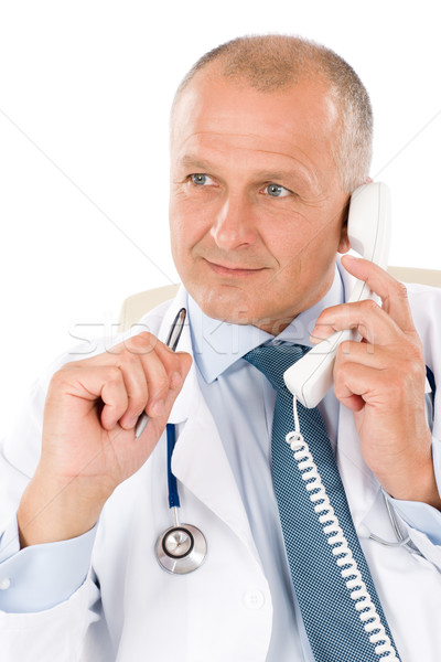 Mature doctor male on phone professional look Stock photo © CandyboxPhoto