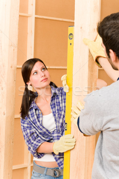 Home improvement smiling couple with spirit level Stock photo © CandyboxPhoto