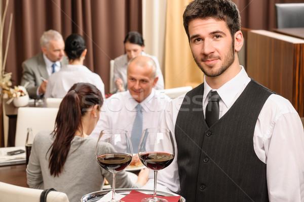 De ober houden wijnglazen business lunch restaurant Stockfoto © CandyboxPhoto