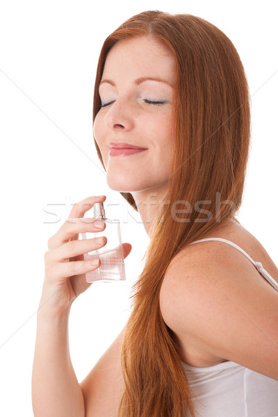 Body care series - Young red hair woman enjoying smell of perfum Stock photo © CandyboxPhoto