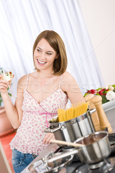Attractive woman cooking spaghetti and tomato sauce  Stock photo © CandyboxPhoto