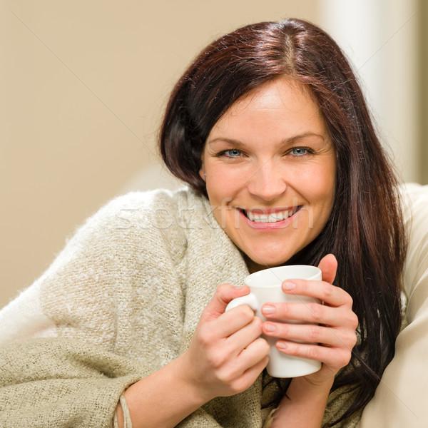 Portrait of joyful woman drinking hot beverage Stock photo © CandyboxPhoto