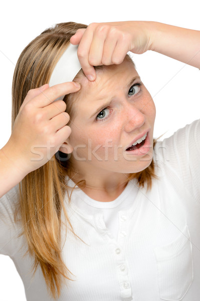 Teenager girl squeezing pimple skin problems spot Stock photo © CandyboxPhoto