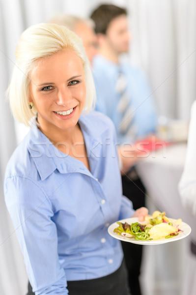 Souriant femme d'affaires société déjeuner buffet tenir Photo stock © CandyboxPhoto