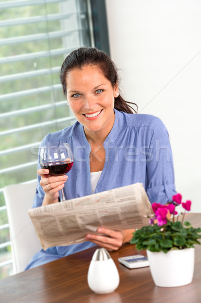 Cheerful woman reading drinking wine newspaper living  Stock photo © CandyboxPhoto
