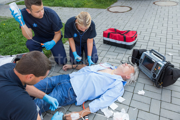 Emergency team giving firstaid to elderly patient Stock photo © CandyboxPhoto