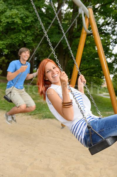 Rire adolescent couple Swing parc amusement Photo stock © CandyboxPhoto