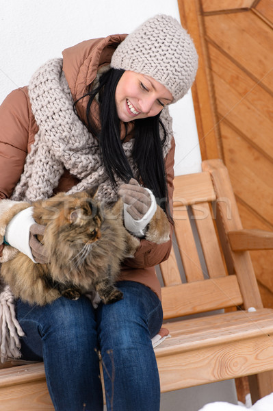 Young woman sitting bench winter stroking cat Stock photo © CandyboxPhoto