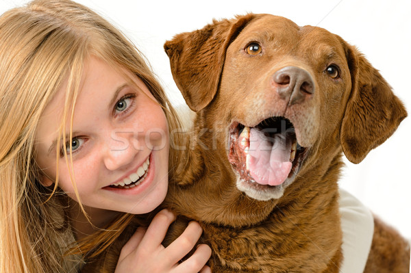 Adolescent girl embracing her golden retriever Stock photo © CandyboxPhoto
