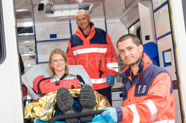 Paramedics helping woman on stretcher in ambulance Stock photo © CandyboxPhoto