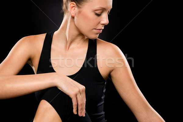 Brunette young woman in spine twisting pose Stock photo © CandyboxPhoto