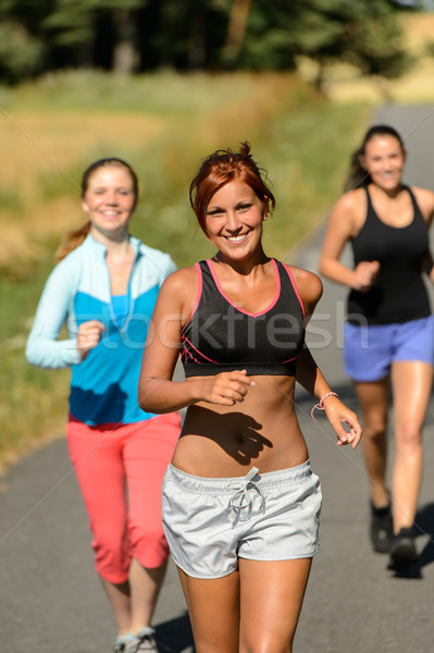 Friends jogging together outdoors sunny path Stock photo © CandyboxPhoto