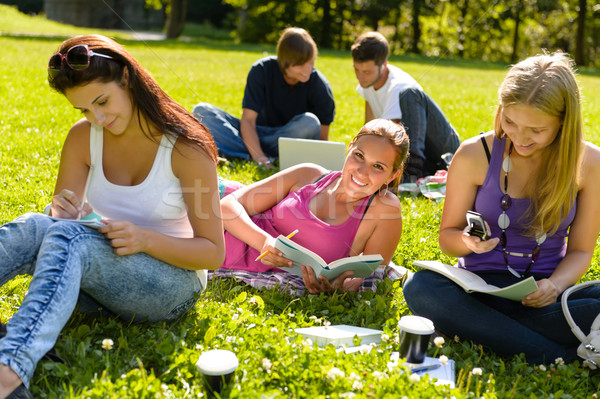 Teens studying in park reading book students Stock photo © CandyboxPhoto
