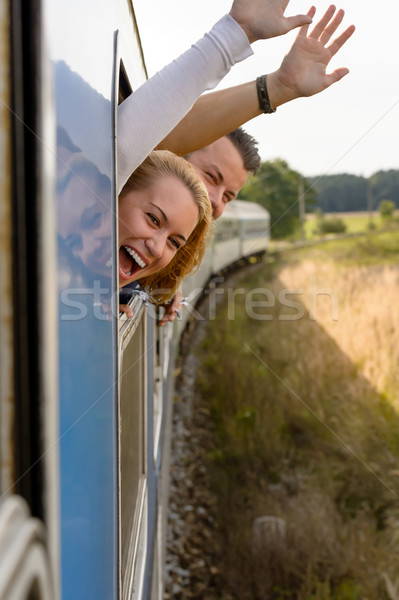 Couple screaming out train window waving happy  Stock photo © CandyboxPhoto