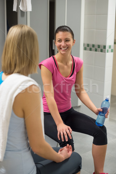 Woman smiling at friend in locker room Stock photo © CandyboxPhoto