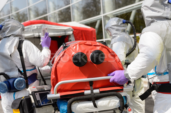 Biohazard team pushing stretcher towards chamber Stock photo © CandyboxPhoto