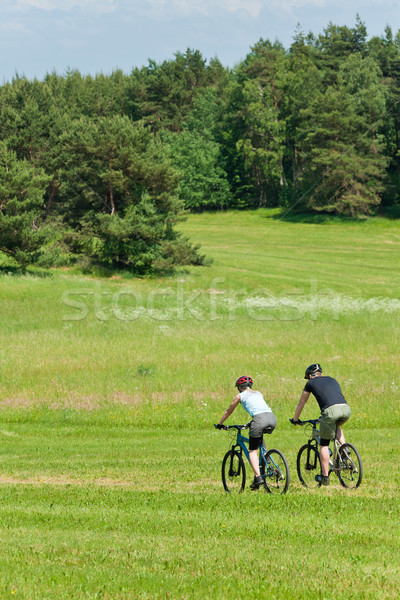 Sport mountain couple biking downhill sunny meadows Stock photo © CandyboxPhoto