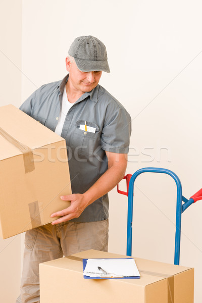 Stock photo: Messenger mature male courier delivering parcels