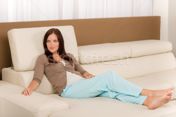 Attractive woman relax living room leather sofa  Stock photo © CandyboxPhoto