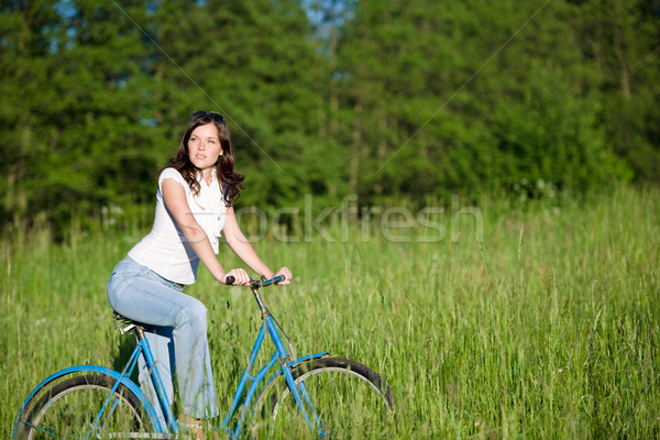 Woman with old-fashioned bike in summer meadow Stock photo © CandyboxPhoto