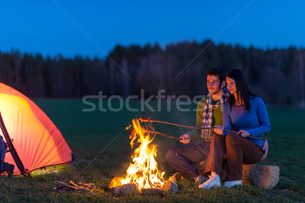 Stock photo: Camping night couple cook by campfire romantic