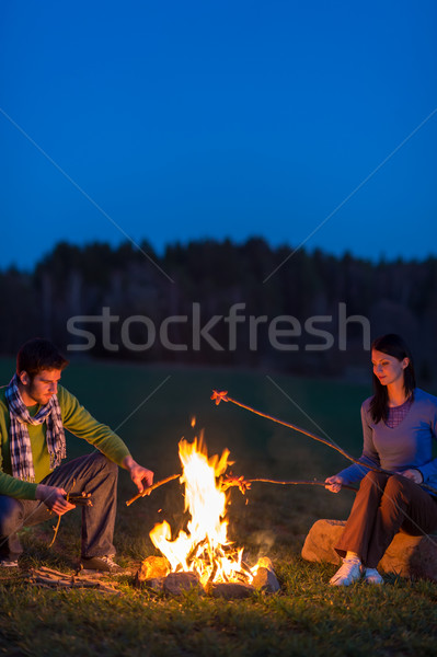 Couple cook by bonfire romantic night countryside Stock photo © CandyboxPhoto