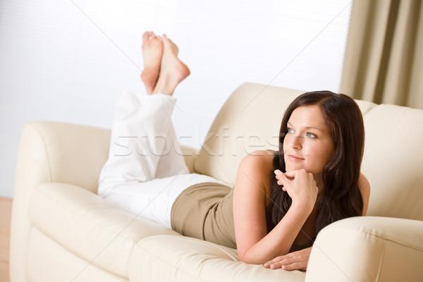 Stockfoto: Jonge · gelukkig · vrouw · ontspannen · sofa