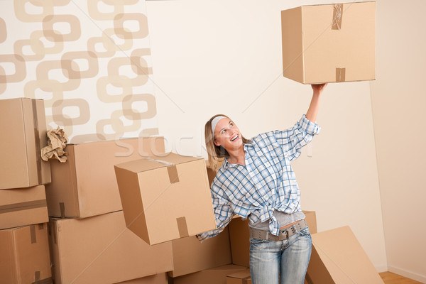 Moving house: Woman holding big carton box Stock photo © CandyboxPhoto