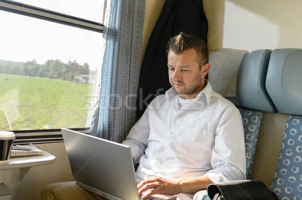 Férfi ingázás vonat laptopot használ utazás komoly Stock fotó © CandyboxPhoto