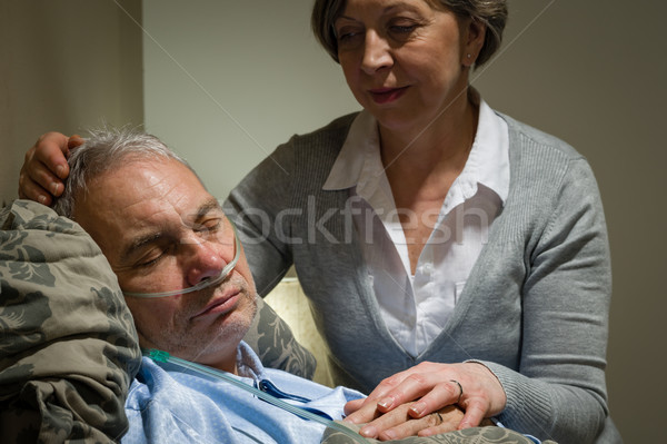 Caring nurse with sleeping senior male patient Stock photo © CandyboxPhoto