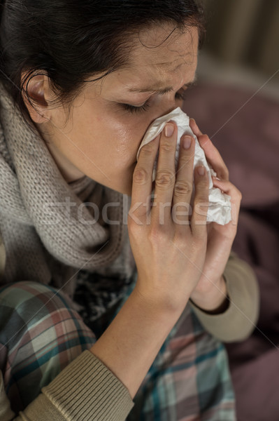 Portrait of woman sneezing into tissue Stock photo © CandyboxPhoto
