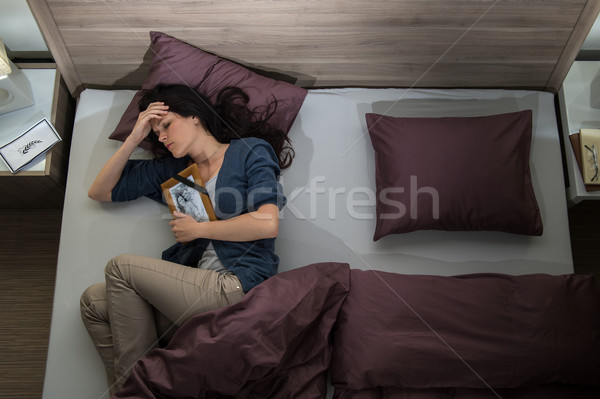 Lonely woman in bed missing dead husband Stock photo © CandyboxPhoto