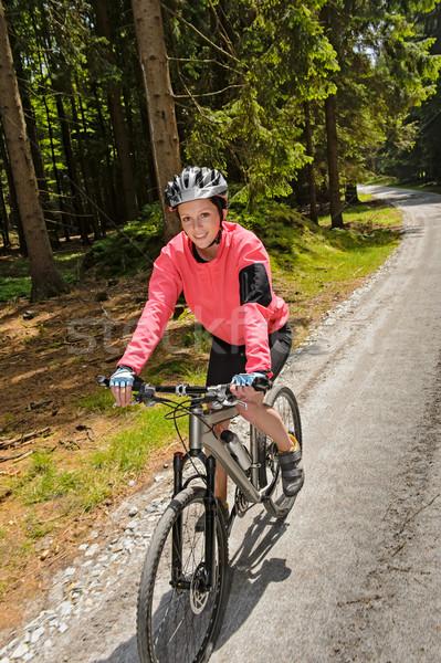 Donna mountain bike sereno foresta donna sorridente ciclismo Foto d'archivio © CandyboxPhoto