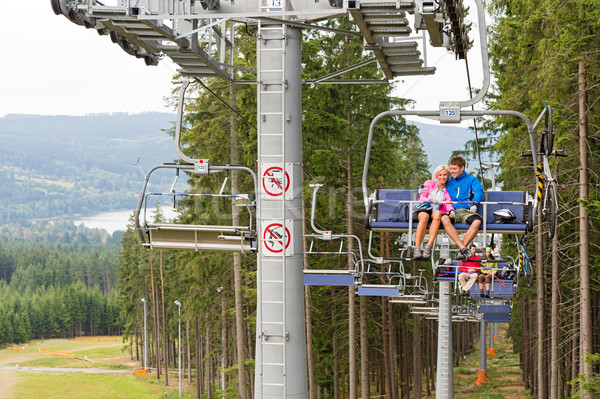 Cuddling couple going through pinewood chair lift Stock photo © CandyboxPhoto
