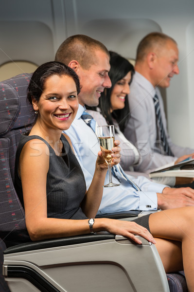 Young businesswoman enjoy flight glass champagne Stock photo © CandyboxPhoto