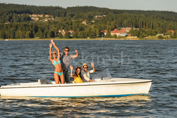 Young friends enjoying summer on speed boat Stock photo © CandyboxPhoto