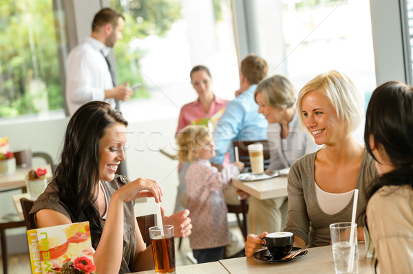 Women friends enjoying a drink at cafe Stock photo © CandyboxPhoto