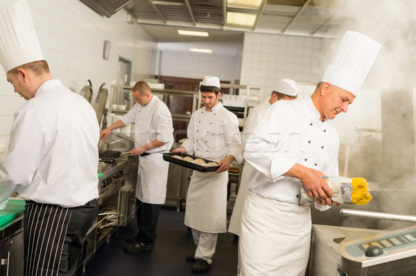 Professional kitchen busy team cooks and chef Stock photo © CandyboxPhoto