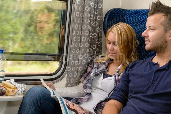 женщину чтение журнала человека глядя поезд Сток-фото © CandyboxPhoto