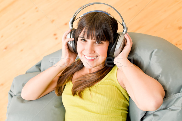 Teenager girl relax home - happy listen to music Stock photo © CandyboxPhoto