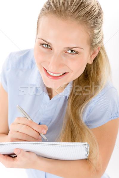 Foto stock: Feliz · estudante · mulher · escrever · notas · branco