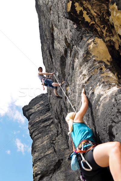 Rotsklimmen mannelijke instructeur vrouw touw houden Stockfoto © CandyboxPhoto