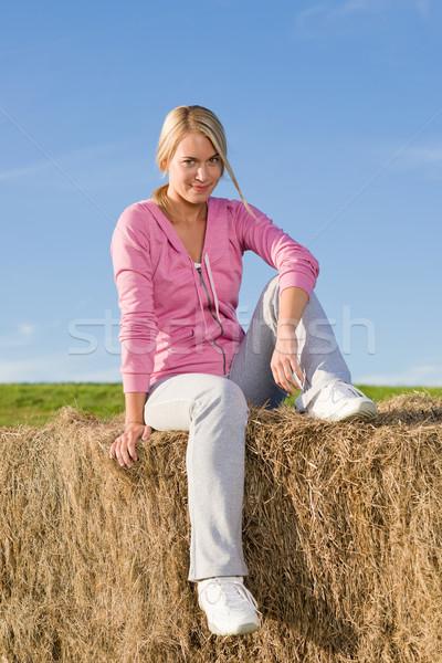 若い女性 リラックス 日没 肖像 座って 乾草 ストックフォト © CandyboxPhoto