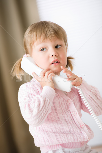 Little girl holding telephone receiver calling Stock photo © CandyboxPhoto