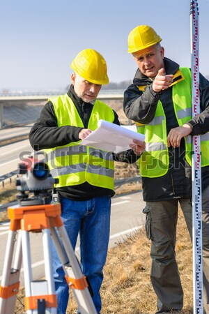 Geodesist wear reflective vest measure land Stock photo © CandyboxPhoto