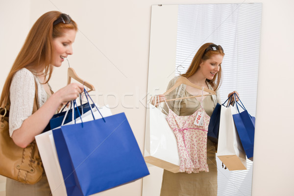 Fashion shopping - Happy woman try on sale clothes Stock photo © CandyboxPhoto