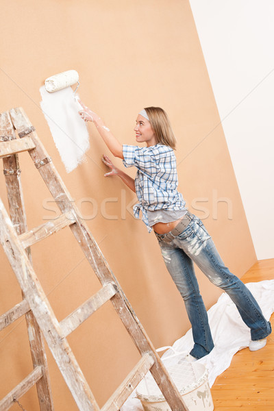 Stock photo: Home improvement: Woman painting wall