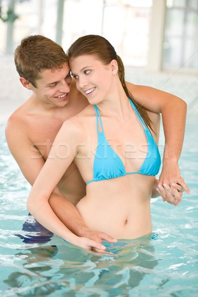 Foto stock: Piscina · jovem · casal · diversão · água