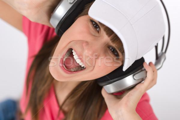 Női tinédzser énekel fejhallgató mosolyog élvezi Stock fotó © CandyboxPhoto