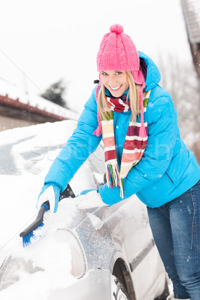 Woman cleaning car hood of snow brush Stock photo © CandyboxPhoto